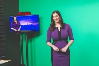 "AccuWeather Broadcast Meteorologist Julia Weiden wears a purple version of ""The Dress."" (Photo/Taliya Riesterer)"